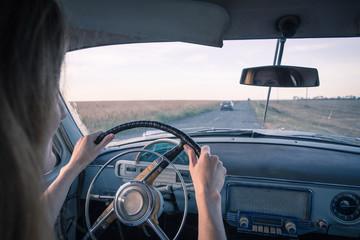 girl in retro car