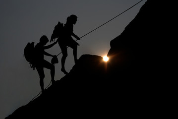 Silhouettes man and effort of climbing.