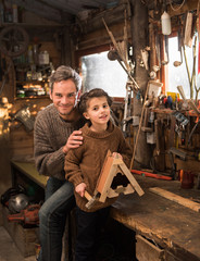 father and his little girl working a rustic wooden workshop