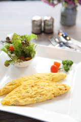 omelette on wood background