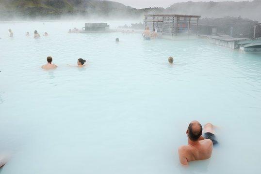 People enjoying hot bath in blue lagoon