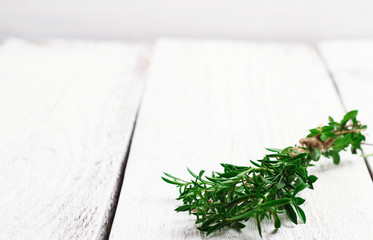 Fresh herbs (savory) on a wooden table