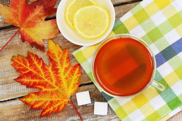 Colorful autumn leaves and lemon tea