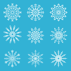 Set of ornate lacy snowflakes. Winter collection. Vector illustration.