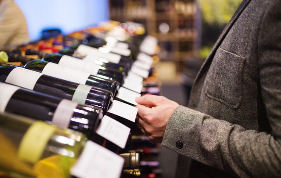 Young man in a wine shop