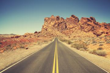 Retro stylized road through rocky desert, Nevada.