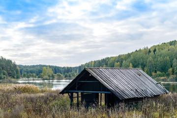 Autumn landscape. Old abandoned village on the empty field. Dete