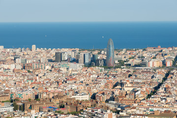 The Torre Agbar in the Poblenou district of Barcelona, surrounded from other skyscrapers. In the foreground, Hospital de la Santa Creu i Sant Pau. The famous hospital is a UNESCO World Heritage Site