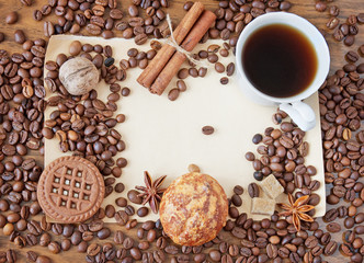Coffee cup,spice and coffee beans on a wooden table