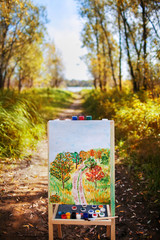 Children's picture on the easel autumn road