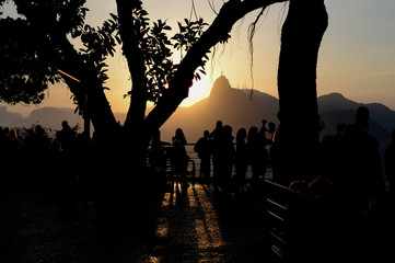 Tourists enjoy the scenery of Christ the Redeemer in Urca