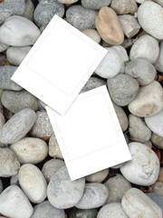 Two square frames on grey pebble background
