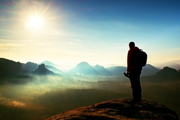 The photographer think about picture at sunset in the misty mountains Wall mural