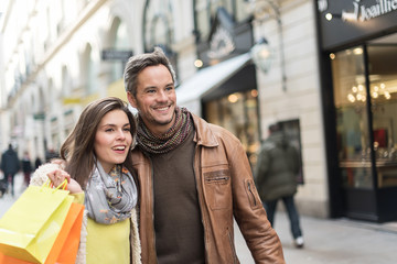 Portrait of a stylish couple doing their shopping in the city