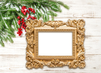 Christmas decoration with golden picture frame on wooden backgro