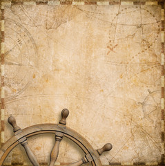 old nautical map with steering wheel