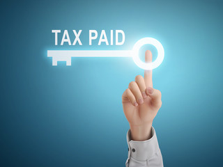 male hand pressing tax paid key button