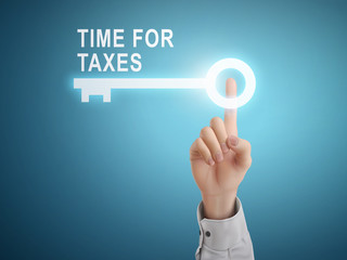 male hand pressing time for taxes key button