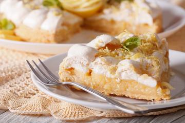 Slice of lemon meringue pie close-up. horizontal