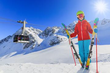 Ski vacation, snow, skier girl enjoying winter