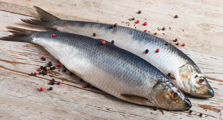 Herrings on a wooden background.