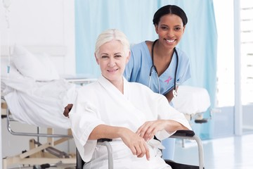 Smiling nurse with female patient