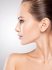 Beautiful health woman face. Profile portrait.