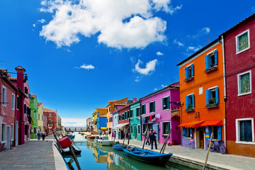 Venice landmark, Burano island, colorful houses and boats, Venice, Italy