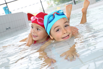 Kids having fun at the swimming pool