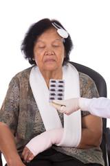 pills with senior woman injured