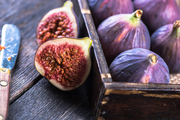 Fresh vibrant whole figs and cut in half