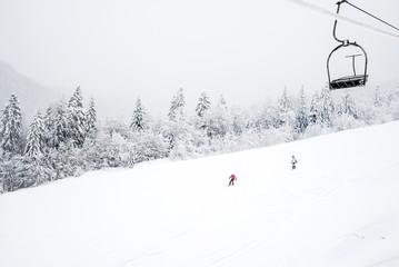 KOLASIN, MONTENEGRO - FEBRUARY 1: Ski slopes among coniferous