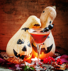 Bloody Halloween cocktail with black olives and pumpkins, select