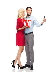 happy couple with smartphone and gift boxes