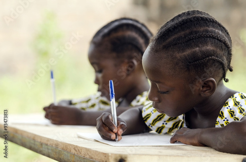 african children at school doing homework african ethnicity  african children at school doing homework african ethnicity students writing their essay in an african