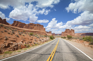 Scenic desert road with beautiful cloudscape, travel concept.