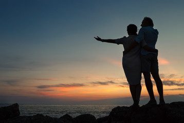 Inlove couple on the seacoast at sunset time
