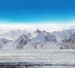 Fototapete - Winter snowy landscape with wooden planks
