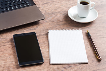 Notebook with glasses, pencil, smart phone and coffee cup