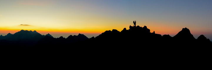 Couple in love in mountains - panorama