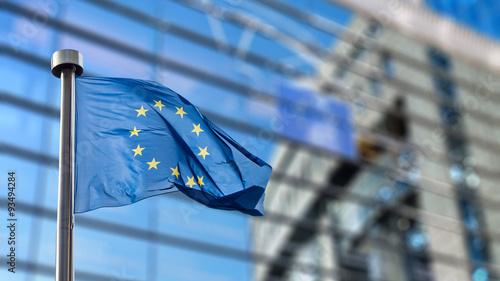 Wall mural European Union flag against European Parliament