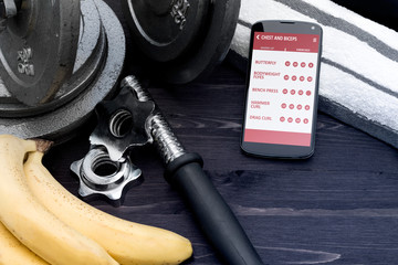 Gym assistant on smartphone. Concept of app for healthcare