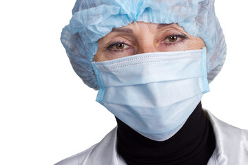 Senior woman surgeon in cap and face mask  over white background
