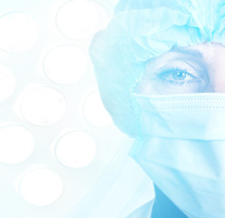 Senior woman surgeon in cap and face mask in surgery room interior