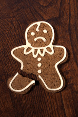 Sad gingerbread man - cookie with a broken leg.