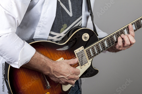 rhythm guitarist strumming an electric guitar stock photo and royalty free images on fotolia. Black Bedroom Furniture Sets. Home Design Ideas