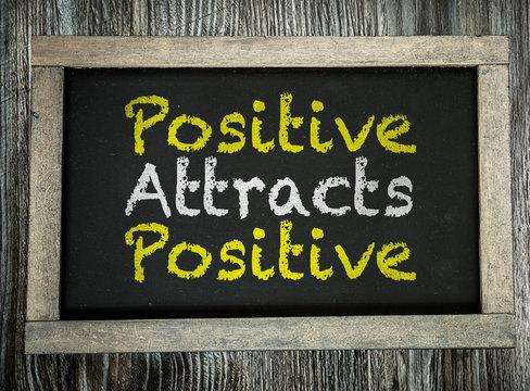 Positive Attracts Positive written on chalkboard