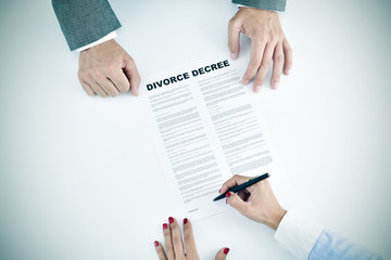 young woman signing a divorce decree document