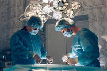 Surgeons team working with Monitoring of patient in surgical