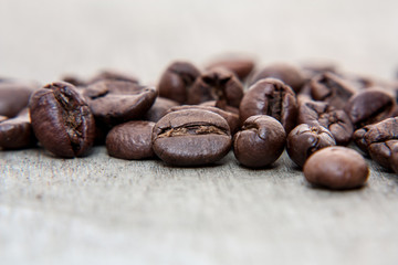 Fresh roasted coffee beans on wooden background